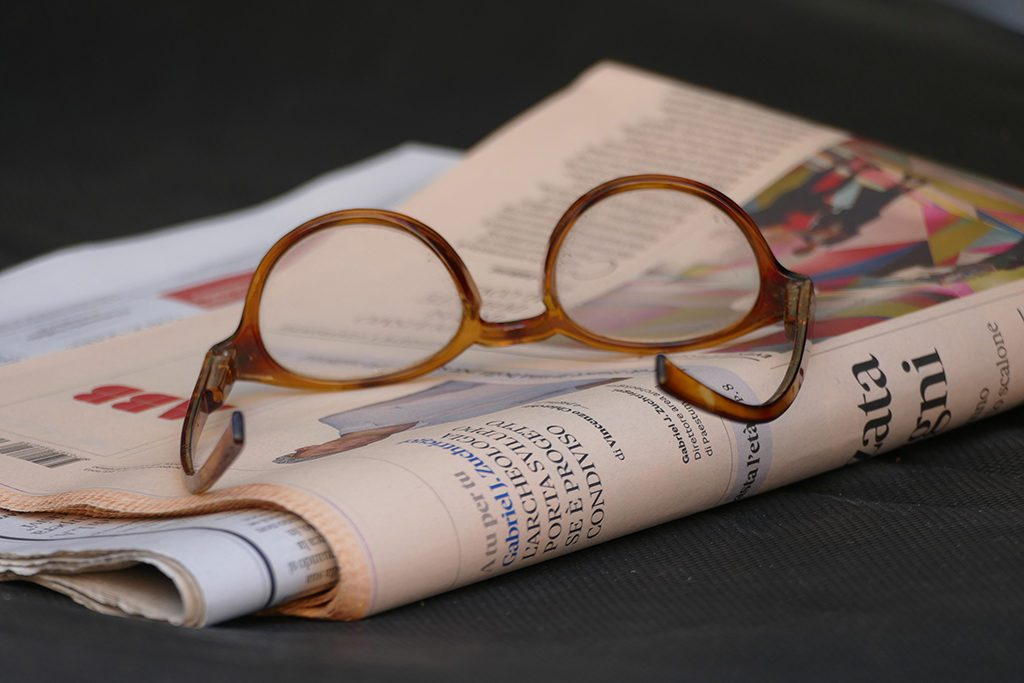 Reading Glasses and an Italian Newspaper