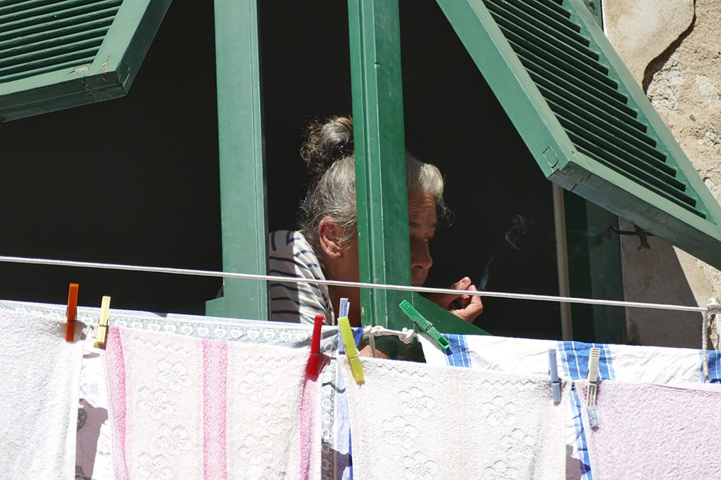 Lady looking out of a window in Vernazza