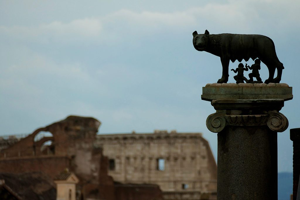 View of The Colosseum and Romolus and Remus drinking from the Capitoline Wolf - some of the Icons of Rome to be visited by first-timers.