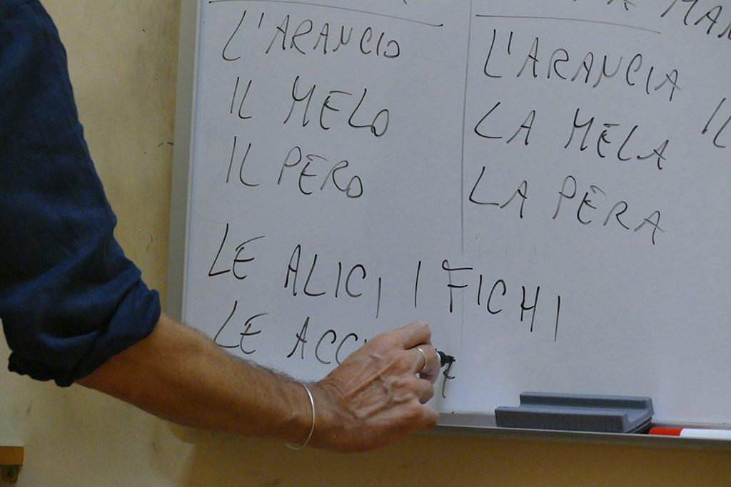 Teacher writes something on the white board.