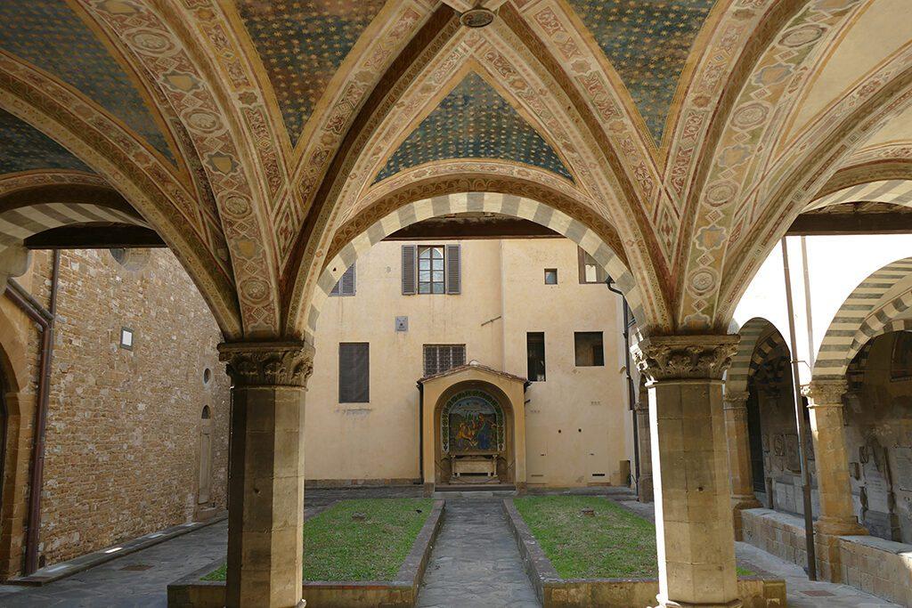 The cloistered courtyard of  Basilica of Santa Maria Novella in Florence