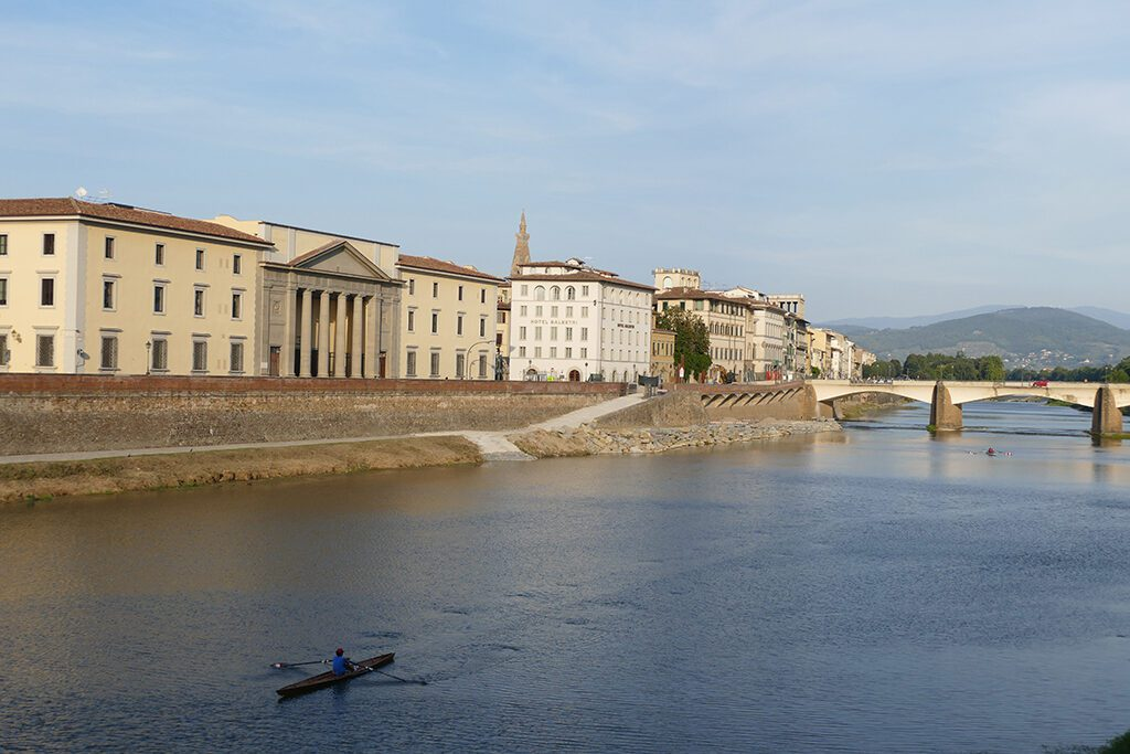 Rower on the river Arno in Florence