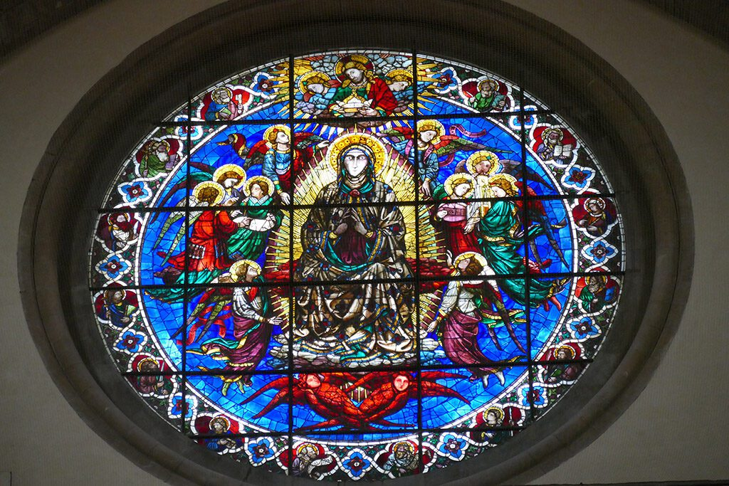 Gaddo Gaddi's circular window Christ crowning Mary as Queen above the main entrance door at the cathedral in Florence