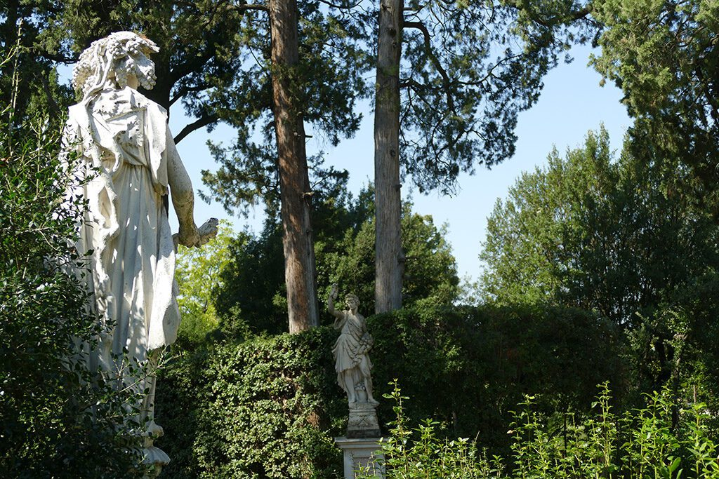 Statue of Flora to the left across from the Statue of Autumn straight ahead at the Boboli Gardens