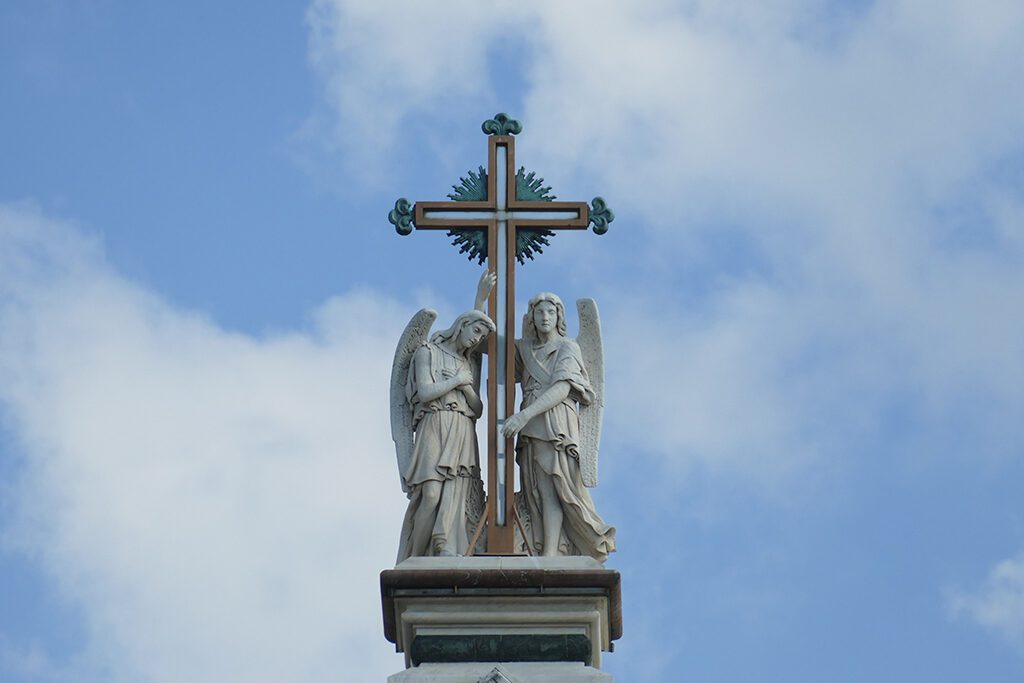 Two angels holding a cross on the very top of the Basilica di Santa Croce in FLORENCE - Home of the Medici, Cradle of the Renaissance