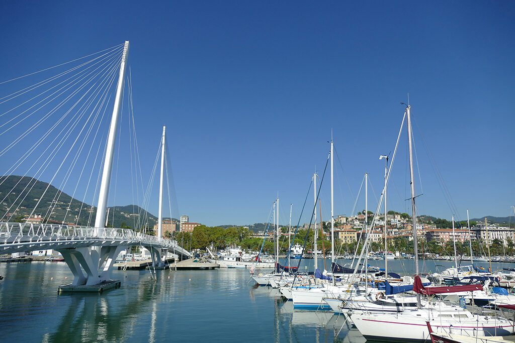 View of the Ponte Thaon di Revel and La Spezia's yacht harbor with the city in the backdrop.