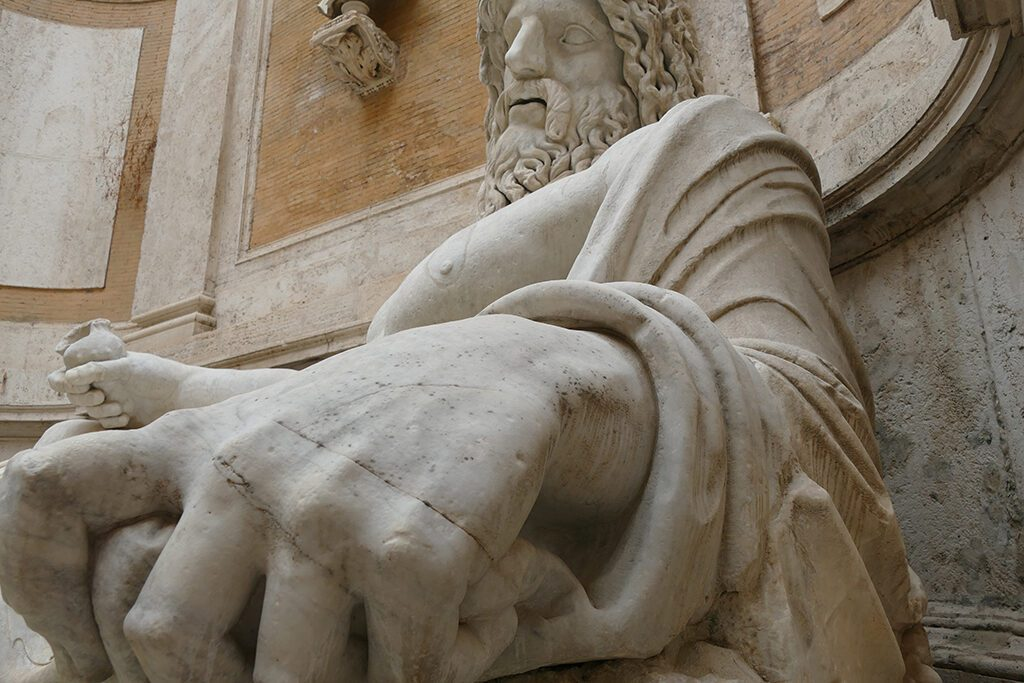 Marforio is a large 1st century Roman marble sculpture of a reclining bearded river god or Oceanus at the Musei Capitolini in Rome.