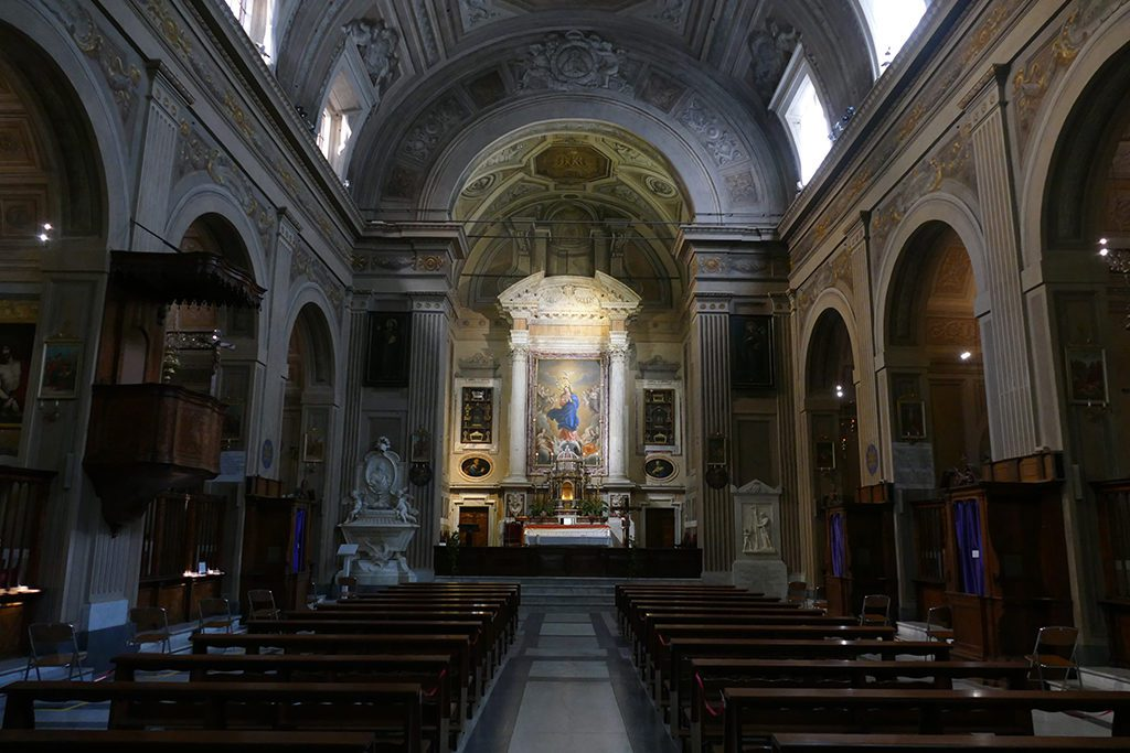 Inside the Santa Maria della Concezione. Behind the altar, Madonna in Glory Among Angels with Saint Felix of Cantalice in Adoration of the Child Jesus by Alessandro Turchi