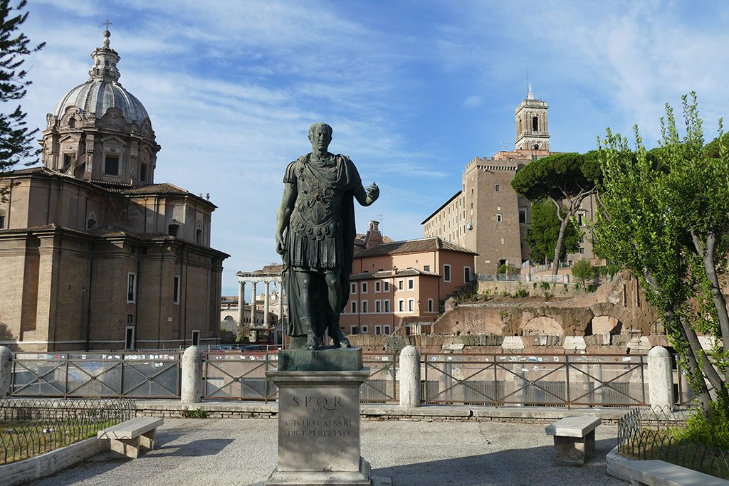 A statue of Iulius Caesar on the Via dei Fori Imperiali, - a must for first-timers.