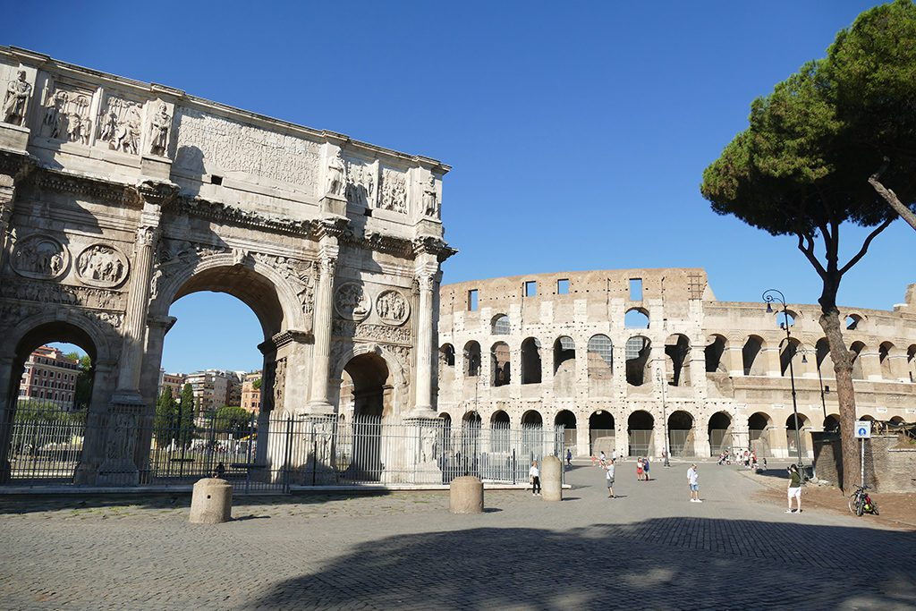 The Roman Colosseum and the overwhelmingly beautiful Arch of Constantine in Rome. A must-see for first timers.