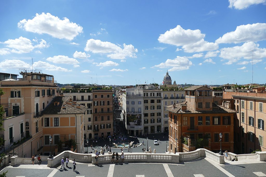 View from the  Church Santa Trinità dei Monti of the panoramic terrace, the Fontana della Barcaccia, and all the way to Saint Peter's Basilica.