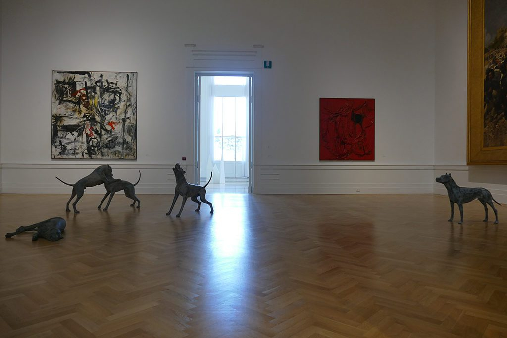 Underdogs by Liliana Moro in front of paintings by Emilio Vedova and Alberto Burri.