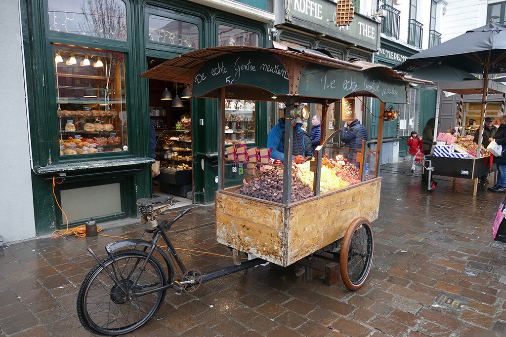 Cart with Belgian delicacies on a day trip to Antwerp, Bruges, and Ghent