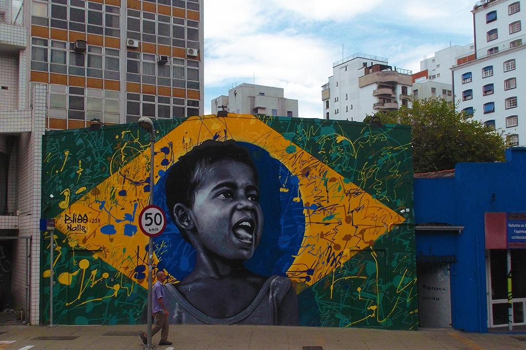 Mural of a boy at SÃO PAULO - Brazil's Art Hub