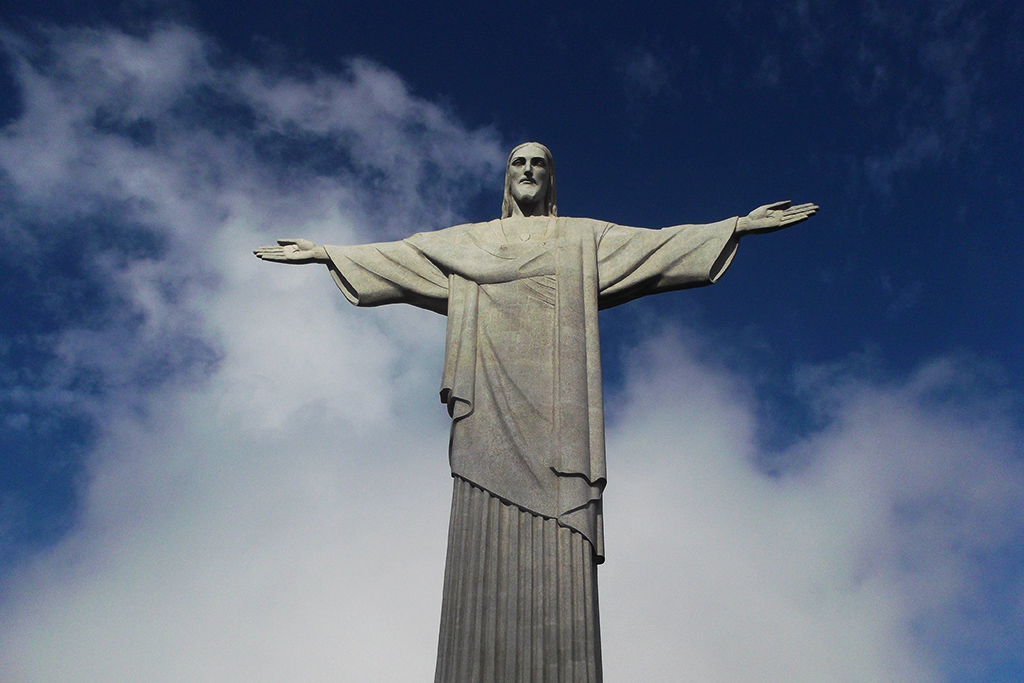 Cristo Redentor spreading his arms above Rio de Janeiro, a rough city in Brazil.