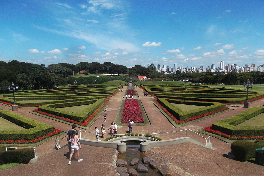 View of the manicured section of the botanic garden with the city of Curitiba in the backdrop.