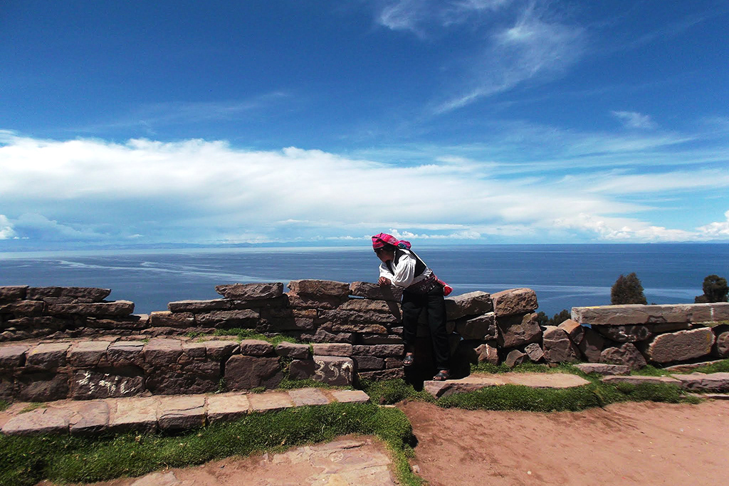 Man overlooking Lake Titicaca on the Taquile island - seen on a daytrip from Puno to the Uros Islands and Isla Taquile