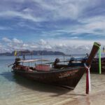 Iconic longtail boats on the shores of the Andaman Sea