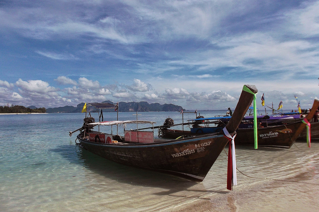 Iconic longtail boats on the shores of the Ao Nang in the Province of Krabi