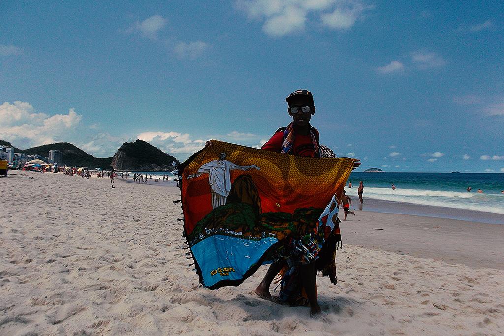Man selling Cangas on the Copacabana Beach in Rio de Janeiro in Brazil.