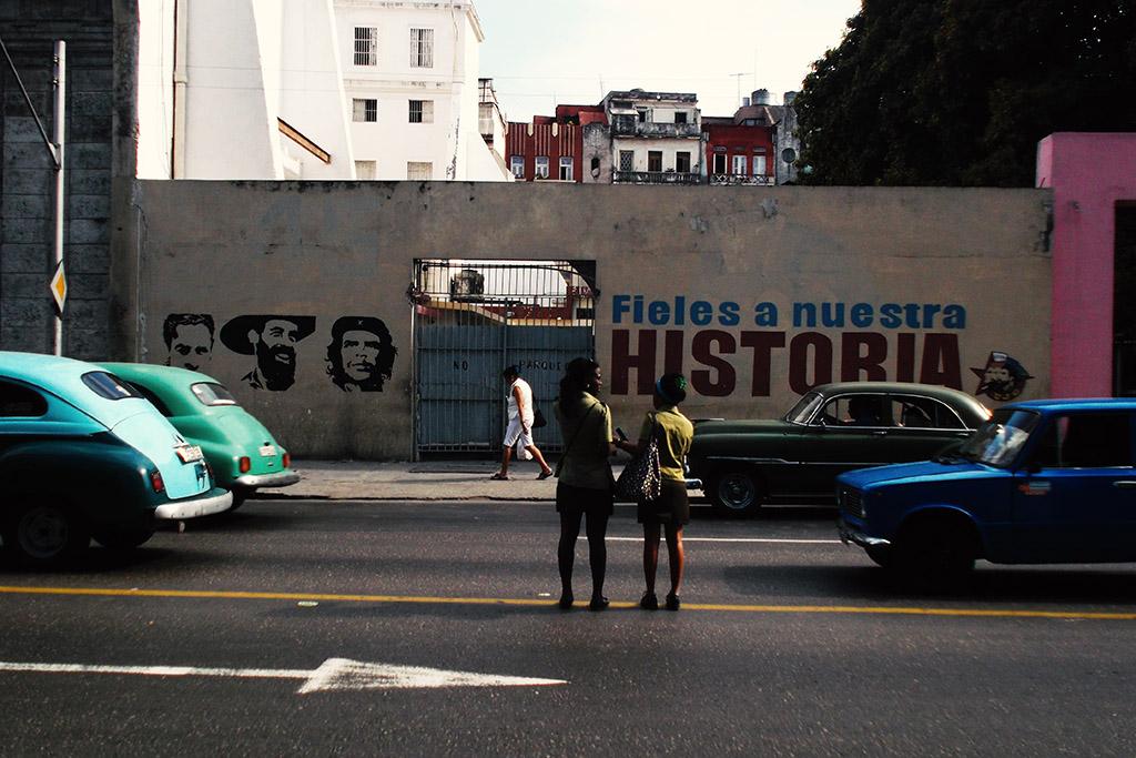 Two women crossing the street in Havana.