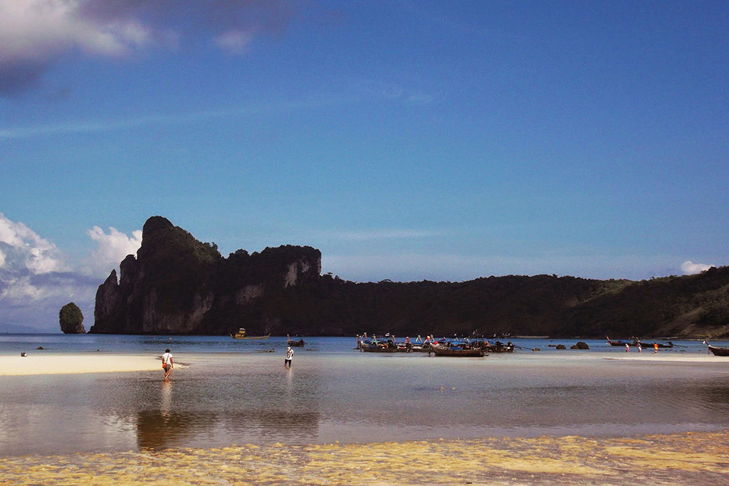 People walking on a beach on Koh Phi Phi in the Andaman Sea