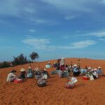 Vendors on the Red Dune of Mui Ne in Vietnam