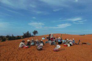 Vendors on the Red Dune of Mui Ne in Vietnam