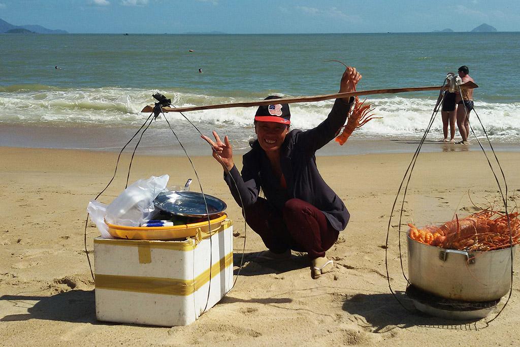 Fish monger on the beach of Nha Trang in Vietnam