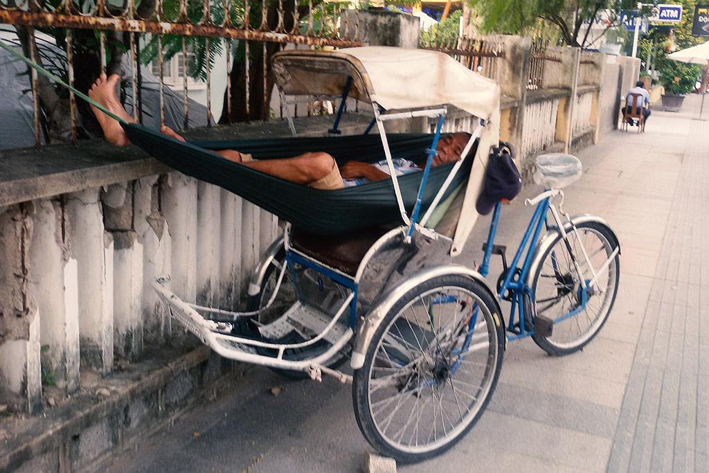 Man sleeping in a rikshaw in Nha Trang