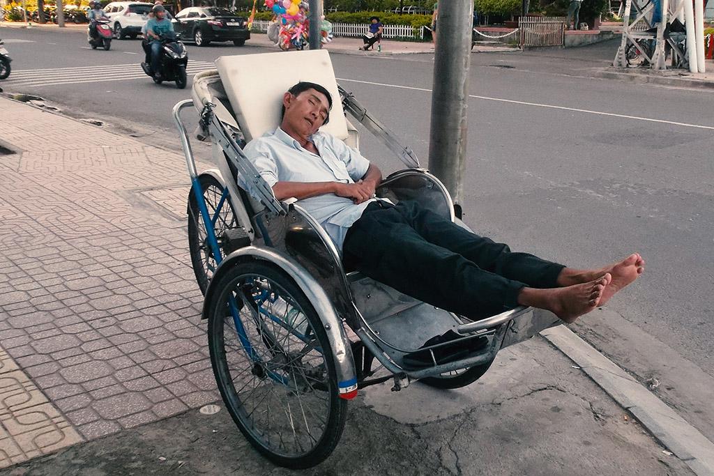 Man sleeping in a Rikshaw in Nha Trang.