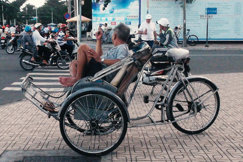 Man in a bicycle rikshaw in Nha Trang.