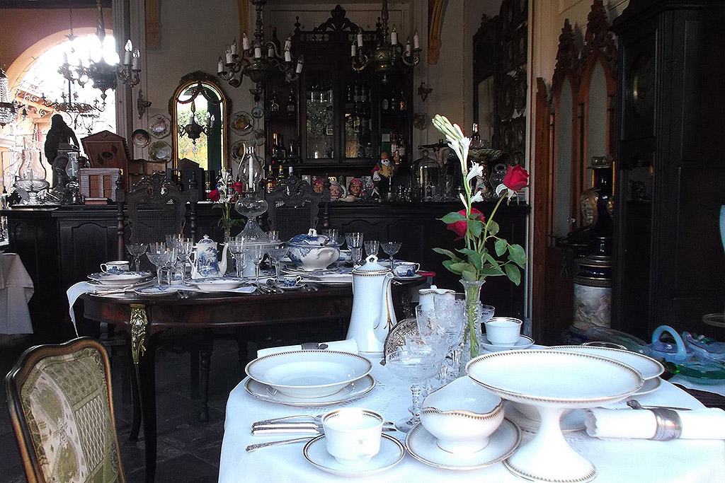 Antique store full of old furniture, chandeliers, crystals, and china in Trinidad, Cuba's Colonial Fantasy.