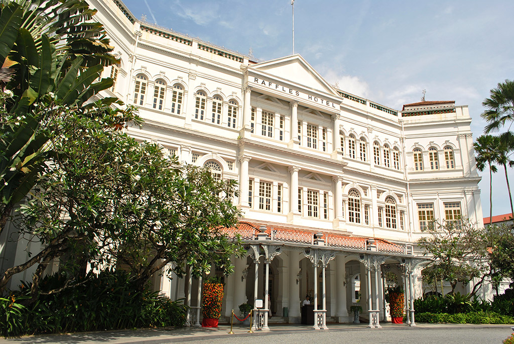 The Raffles Hotel which houses the famous Long Bar where the Singapore Sling was invented.