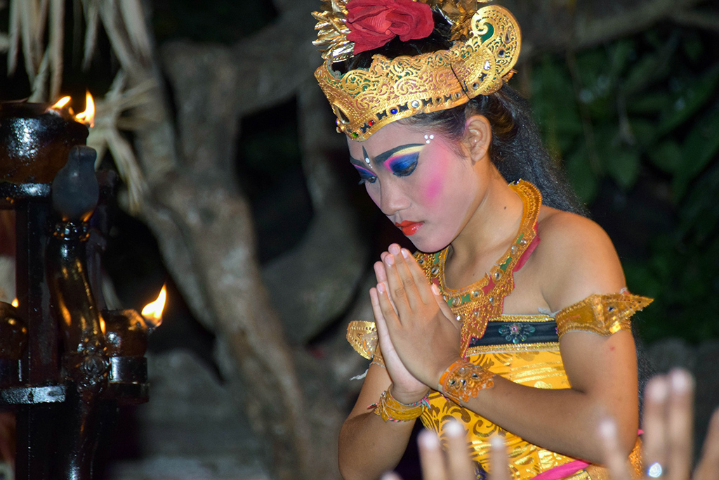 Balinese Lady holding her hands in prayer