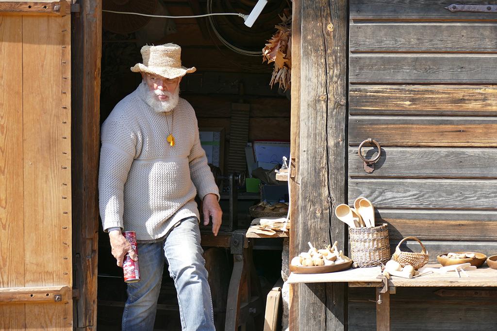 Riga Latvia - Gentlemen selling wooden goods