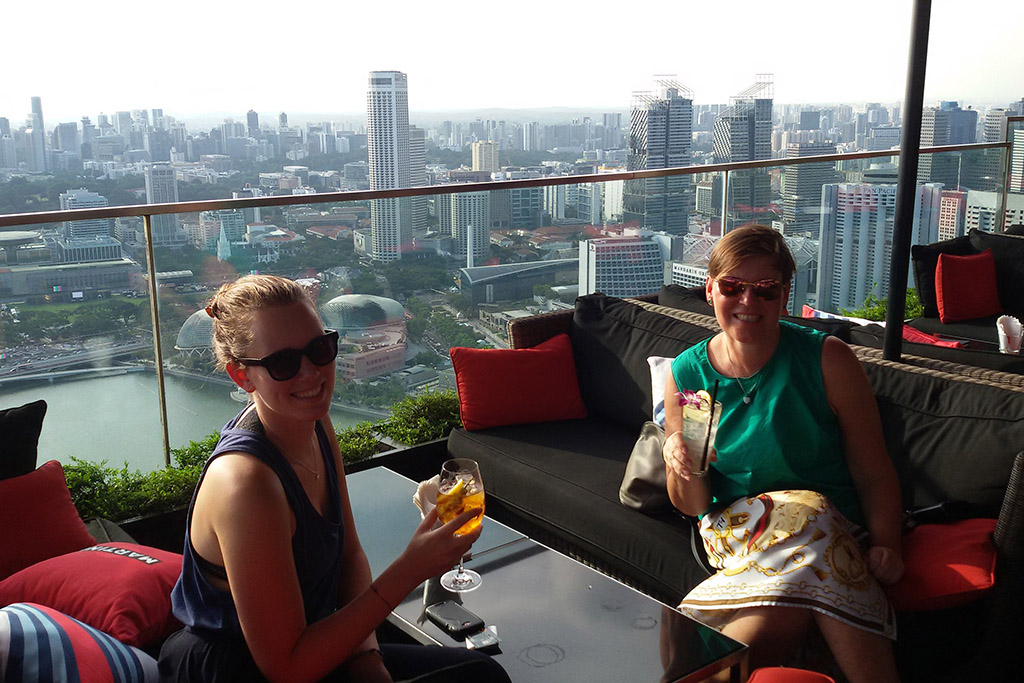 Renata Green enjoying a cocktail at the  CÉ LA VI  Bar at the Marina Bay Sands Hotel.
