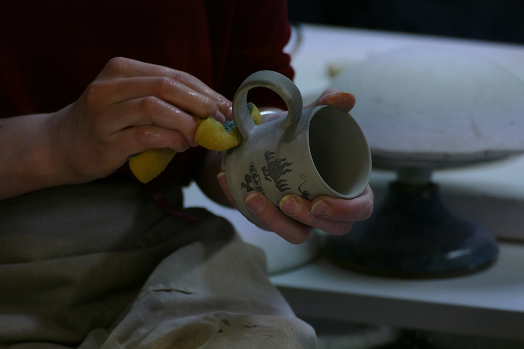 Woman making pottery in Tallinn, the city between the poles of history and creativity