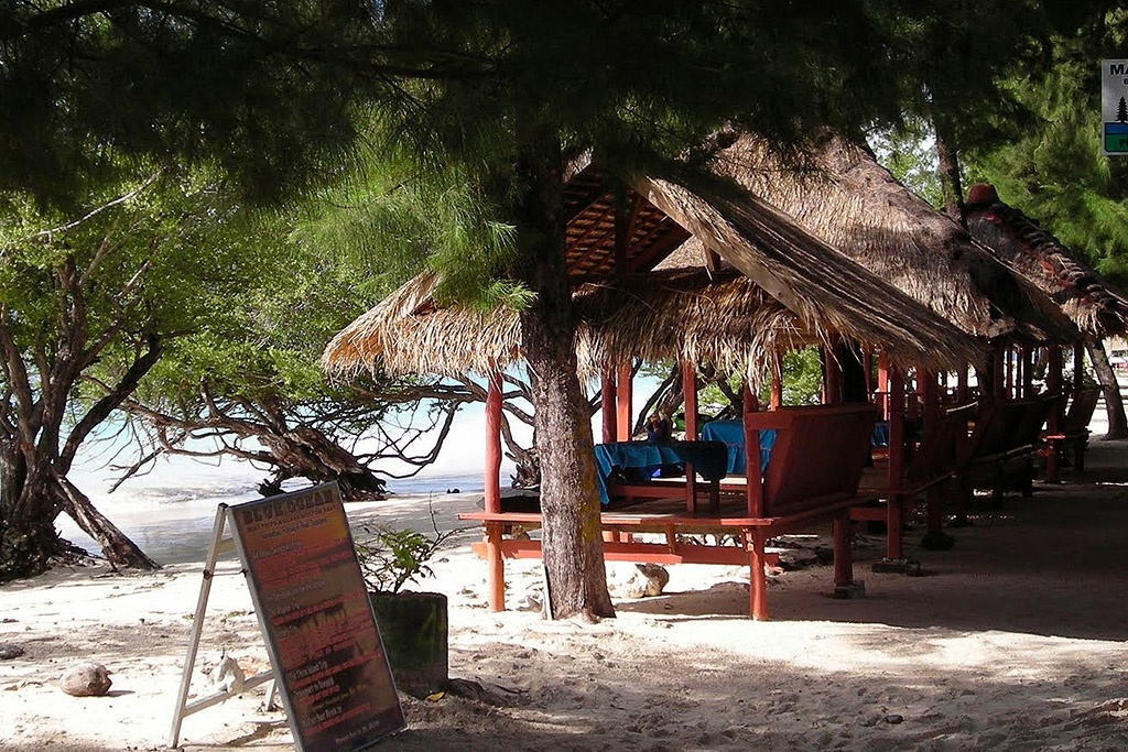 Pavilions at a beach restaurant on Gili Meno
