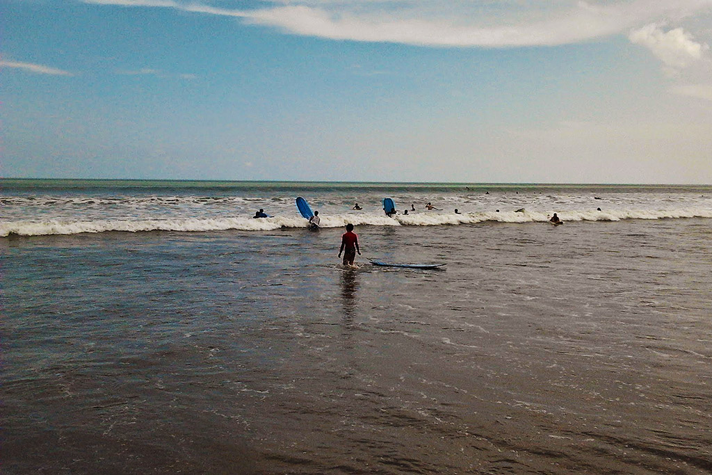 Surfers on Legian Beach in Bali