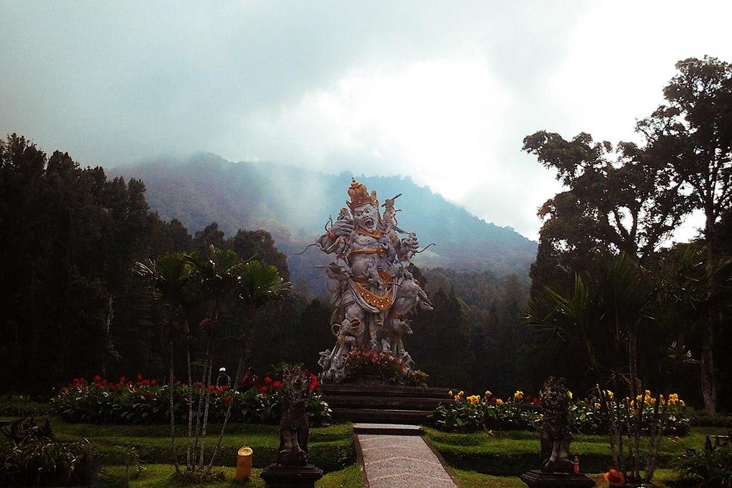 statue of demon Kumbhakarna attacked by monkeys at the Kebun Raya Bali Botanical Garden not far from Lovina