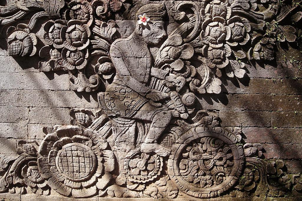 Relief of Dutch artist W. O.J. Nieuwenkamp who explored Bali by bicycle in 1904 at Pura Meduwe Karang