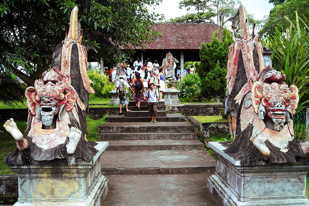 Demon statues at he eleven-storey high fountain in the backdrop is one of Taman Tirta Gangga