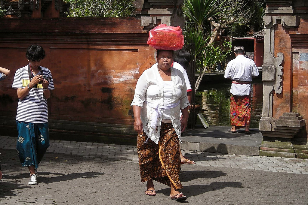 Visitors to Tirta Empul on a day trip from Ubud
