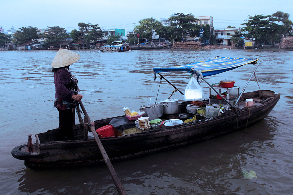 Vendor on the floating market of Cai Rang