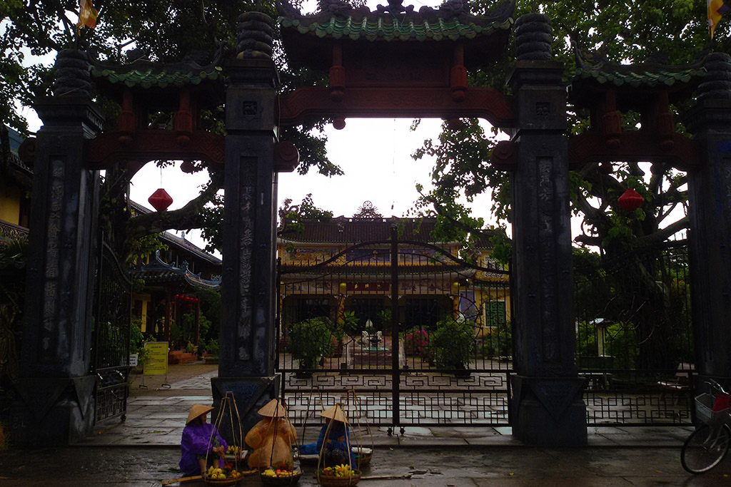 Three ladies in front of the Chua Phap Bao Buddhist Temple In Hoi An