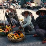 Three street vendors in Hoi An