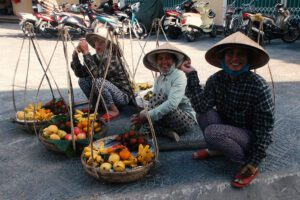 Three street vendors in Hoi An