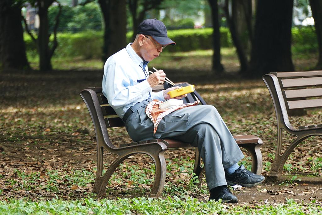 Man eating at Yoyogi Park at Tokyo in Japan