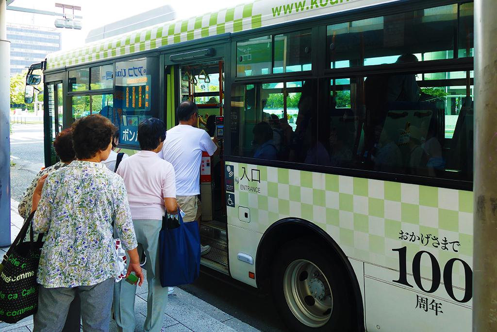 People boarding the bus in Hiroshima Japan